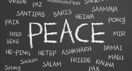peace word cloud written in many different languages on a chalkboard